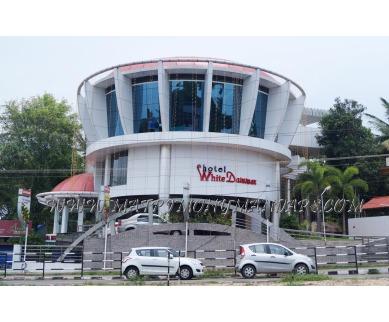 Explore Hotel White Dammar Mango tree (A/C) in Pappanamcode, Trivandrum - Hotel Facade