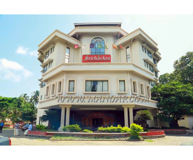 Find the availability of Hotel Srichakra International (A/C)  in Chandranagar, Palakkad and avail the special offers
